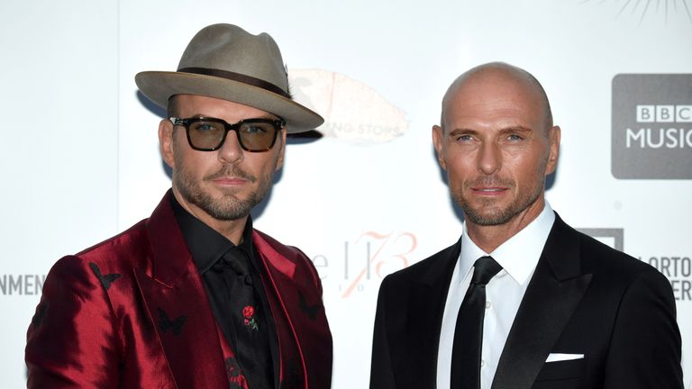 British singers Matt Goss (L) and Luke Goss, of the band Bros, pose upon arrival for the UK premiere of the film 'Bros: After The Screaming Stops' during the BFI London Film Festival in London on October 17, 2018