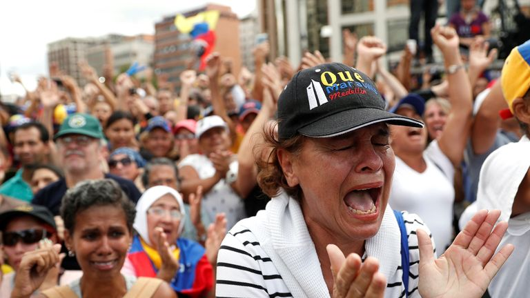 A woman celebrates after Mr Guaido declares himself interim president