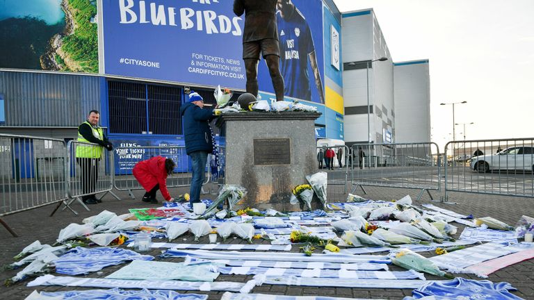 Flowers and scarves have been left outside Cardiff City's stadium