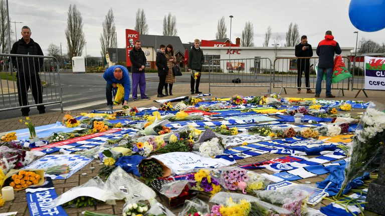 Flowers laid outside the stadium in Cardiff