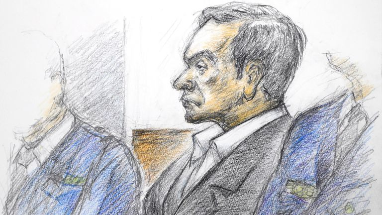 This courtroom sketch illustrated by Masato Yamashita depicts former Nissan chairman Carlos Ghosn attending his hearing at the Tokyo district court on January 8, 2019.