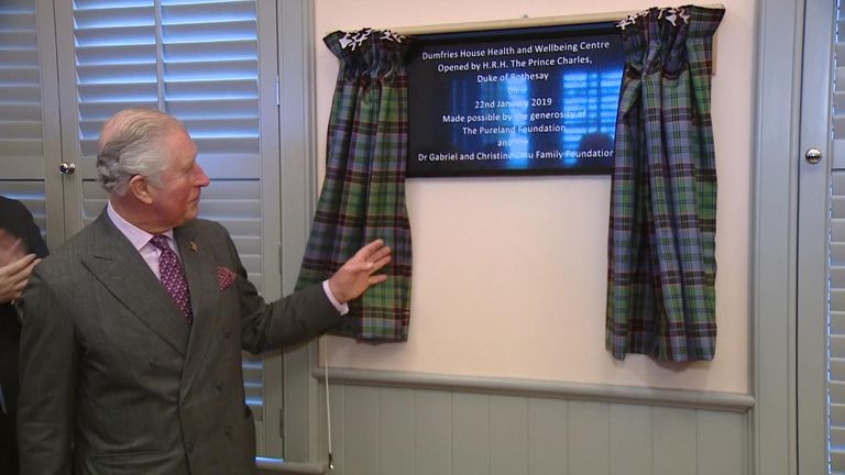 Prince Charles unveils a plaque at the centre