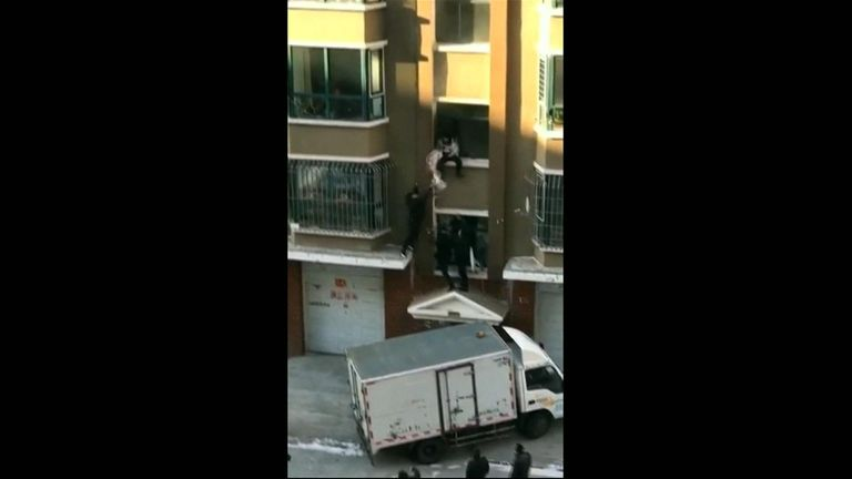 A heroic Chinese milkman caught a baby falling from a building just in the nick of time.