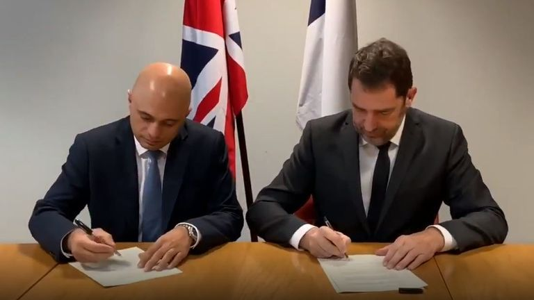 Christophe Castaner and Sajid Javid sign a deal for better cross-channel migrant monitoring
