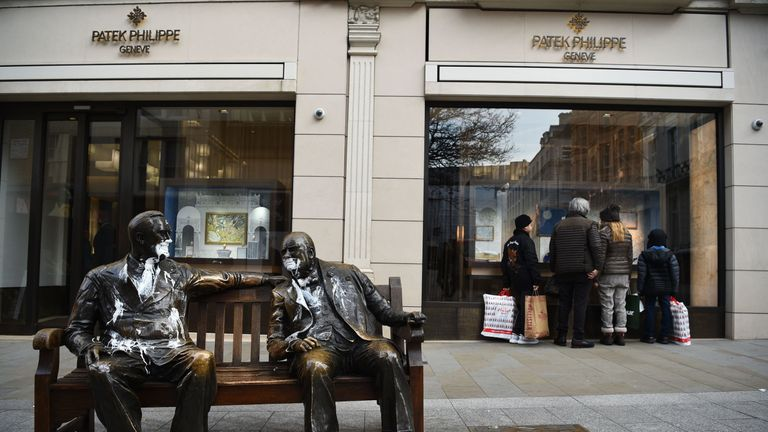 The figures of Franklin D Roosevelt and Winston Churchill on the Allies sculpture in New Bond Street, London, which has been vandalised with white paint