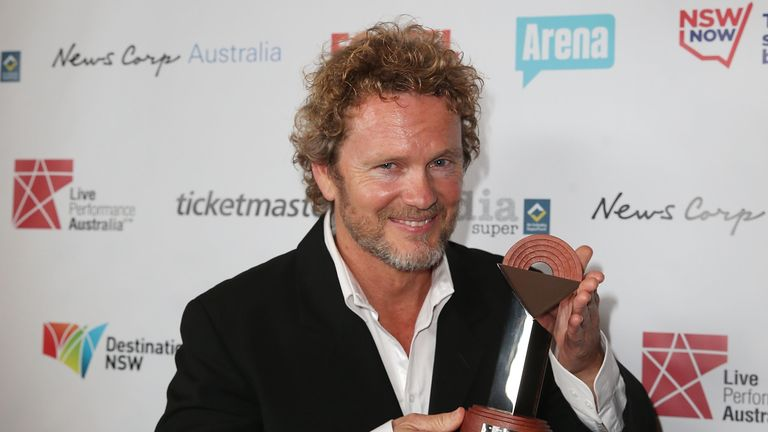 Craig McLachlan poses with the award for Best Actor in a Musical at the Capitol Theatre on August 18, 2014 in Sydney, Australia