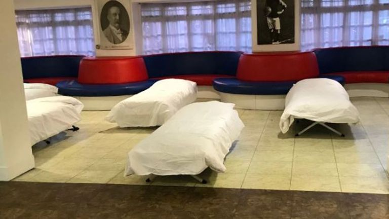 Camp beds have been set up in a lounge at the stadium