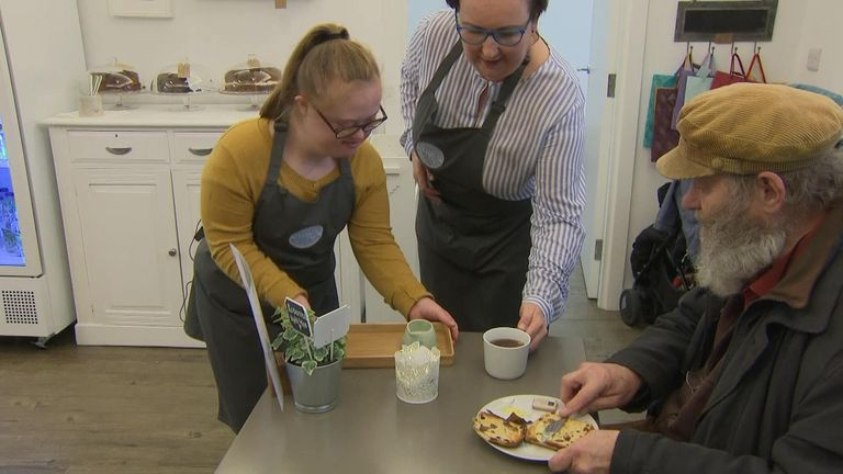 A cafe set up to teach life and work skills to youngsters with Down Syndrome is calling on employers to give a helping hand to people with learning difficulties