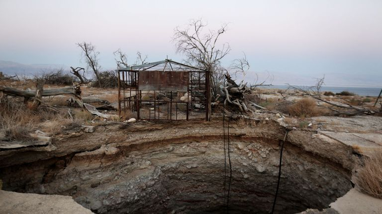 A general view shows a sinkhole in Israel's abandoned tourist resort of Ein Gedi on the shore of the Dead Sea on July 11, 2016
