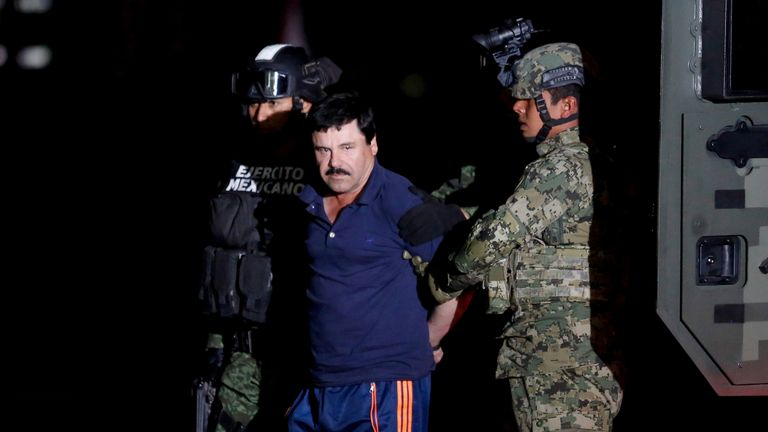 """Joaquin """"El Chapo"""" Guzman is escorted by soldiers during a presentation in Mexico City in 2016"""