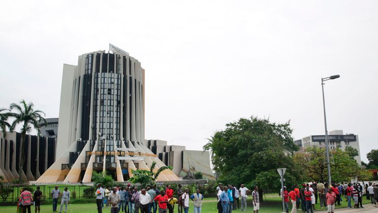 People gathered outside the HQ of Gabon's national broadcaster RTG
