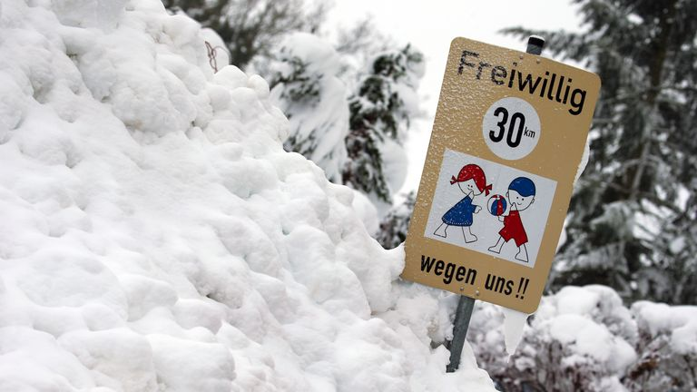 A sign is near buried in snowfall in Aitrang, southern Germany