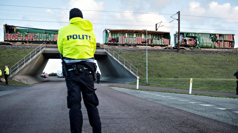 Police keep guard after a train accident on the Great Belt Bridge in Denmark