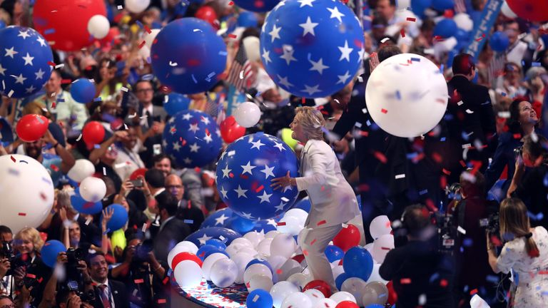 Hillary Clinton plays with balloons on stage at the Democratic National Convention in Philadelphia