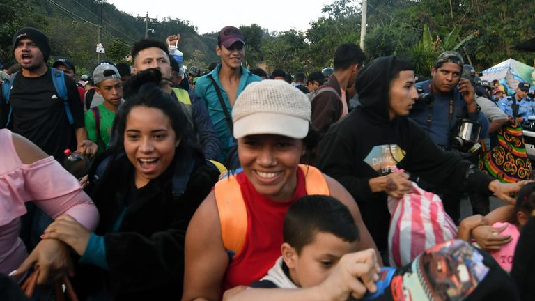 Honduran migrants smile as they make it through the cordon