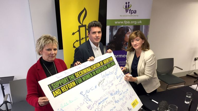 Conservative MPs (left to right) Anna Soubry, Huw Merriman and Nicky Morgan urging reform of NIÕs abortion laws, during their visit to the Metropolitan Arts Centre (MAC), Belfast.