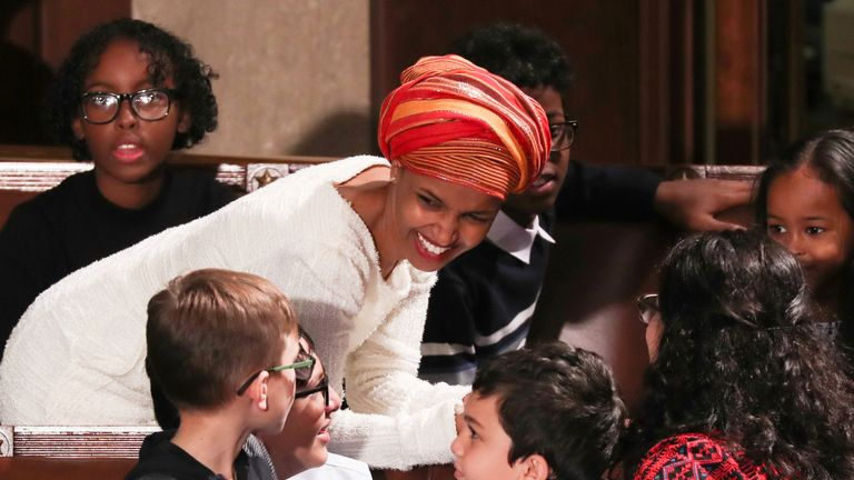 U.S. Representative-elect Ilhan Omar (D-MI) chats to children in the House Chamber