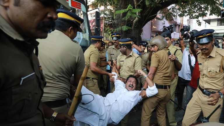 Indian police carry an activist away