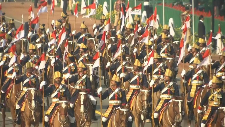 Thousands of people converged on a ceremonial boulevard in New Delhi to watch a display of the country's military power and cultural diversity amid tight security during Saturday's national day celebrations.