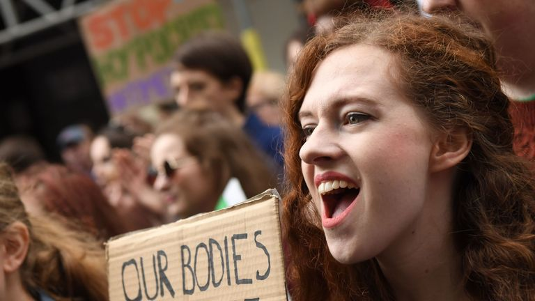 Protesters hold up placards during the London March for Choice, calling for the legalising of abortion in Ireland after the referendum announcement, outside the Embassy of Ireland in central London on September 30, 2017. Tens of thousands are expected at a rally for abortion rights in Dublin on September 30, campaigning on one side of a fierce debate after Ireland announced it will hold a referendum on the issue next year. / AFP PHOTO / CHRIS J RATCLIFFE (Photo credit should read CHRIS J RATCLIF