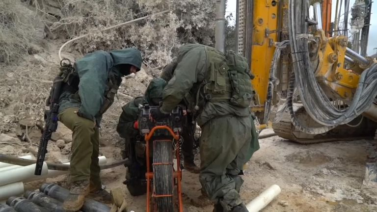 Military work on Operation Northern Shield to find the tunnels