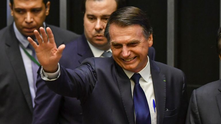 Jair Bolsonaro waves at Congress before he is sworn in as Brazil's new president