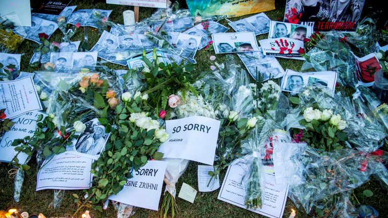 This picture shows texts, pictures and candles laid down as Moroccans pay tribute to murdered Danish Louisa Vesterager Jespersen and Norwegian Maren Ueland in Rabat, in front the Norwegian embassy on December 22, 2018
