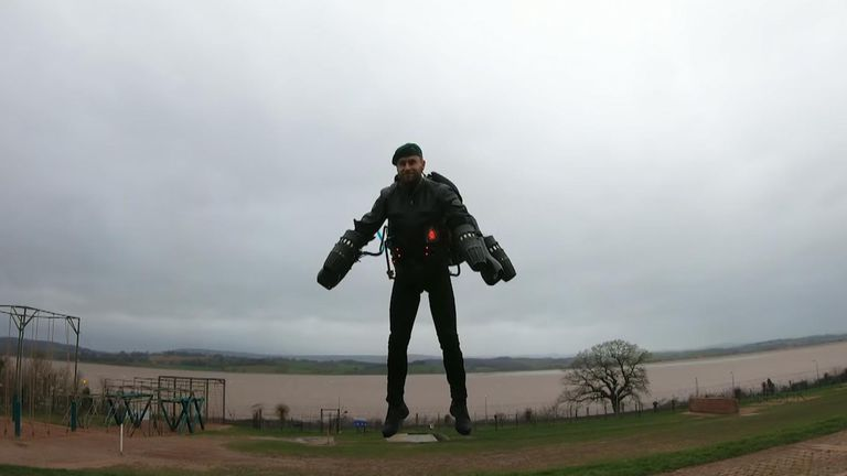 Richard Browning showed off the jet pack his company has developed at a Royal Marines assault course in  Lympstone, Devon.