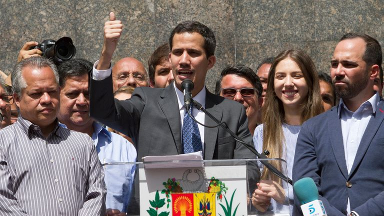 Juan Guaido, centre, speaks in Venezuela