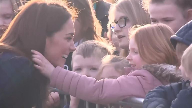 The Duchess of Cambridge met a young fan in Dundee, exchanging high fives and laughing as the eager child played with her hair.