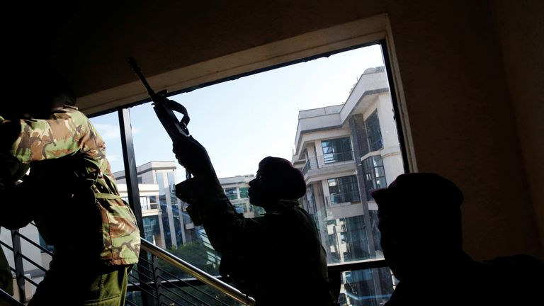 Kenyan troops search a building for the gunman