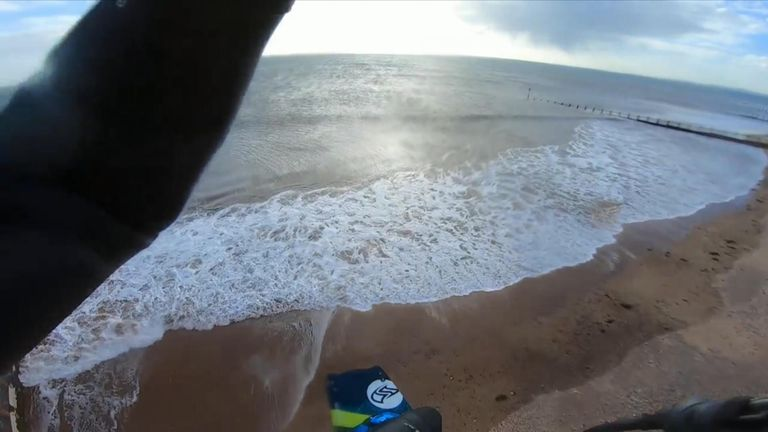 Former freestyle kite surfing champion Olly Bridge jumps from a river and glides across a 200-metre sand pit before landing at sea.