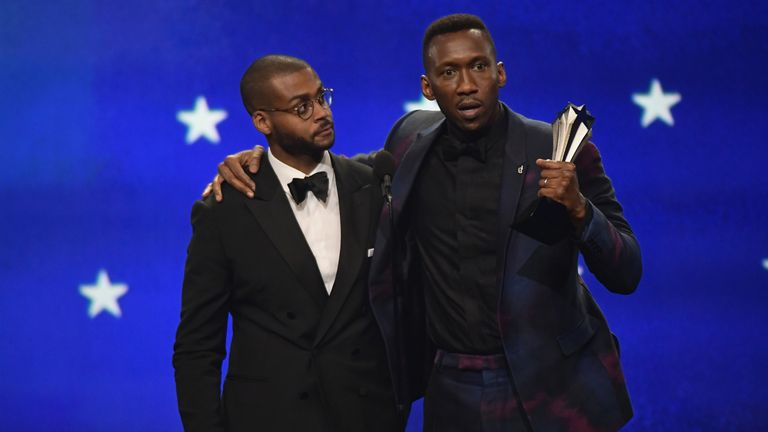 Mahershala Ali (R) accepts the award for Best Supporting Actor with Kris Bowers onstage during the 24th annual Critics' Choice Awards