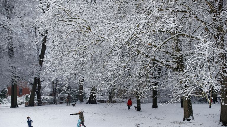 Children play in the snow in Manchester