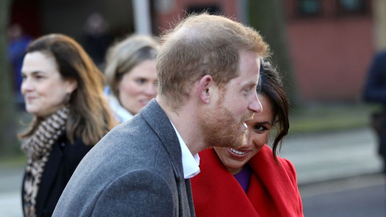 The Duke and Duchess of Sussex are given a gift of a teddy bear as they meet members of the public on a walkabout at a new sculpture in Hamilton Square to mark the 100th anniversary of war poet Wilfred Owen...s death,  during a visit to Birkenhead. PRESS ASSOCIATION Photo. Picture date: Monday January 14, 2019. See PA story ROYAL Sussex. Photo credit should read: Aaron Chown/PA Wire