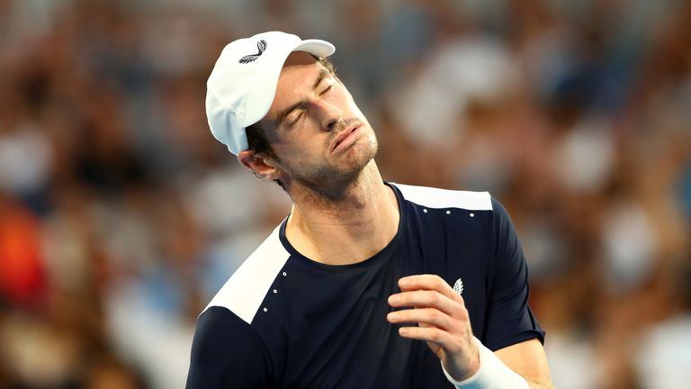 MELBOURNE, AUSTRALIA - JANUARY 14: Andy Murray of Great Britain reacts in his first round match against Roberto Bautista Agut of Spain during day one of the 2019 Australian Open at Melbourne Park on January 14, 2019 in Melbourne, Australia. (Photo by Julian Finney/Getty Images)