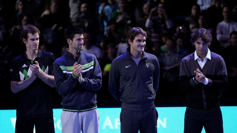 Andy Murray of Great Britain, Novak Djokovic of Siberia, Roger Federer of Switzerland and Rafael Nadal of Spain attend a ceremony for Carlos Moya's retirement during the Barclays ATP World Tour Finals at O2 Arena on November 21, 2010 in London, England
