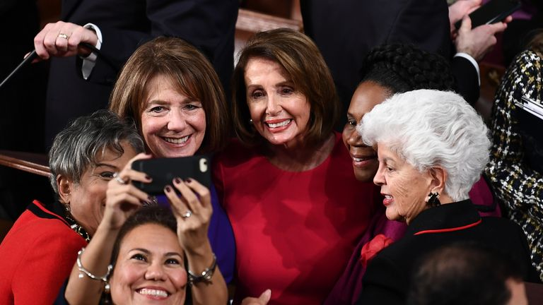 Nancy Pelosi poses for a selfie with fellow female congress members
