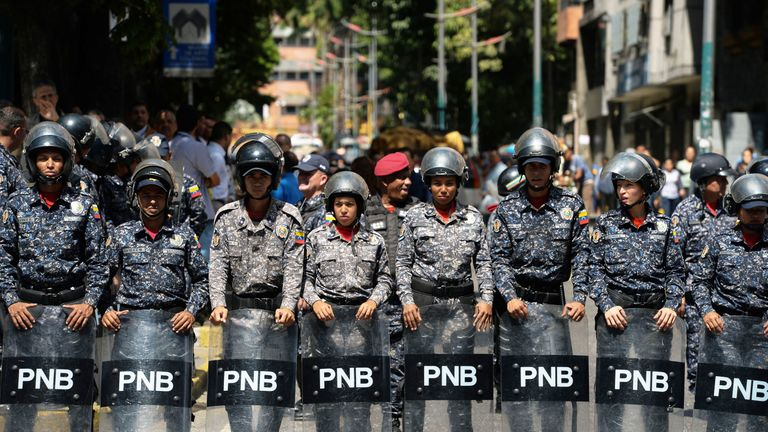 National police stand guard during an anti-government protests in Venezuela