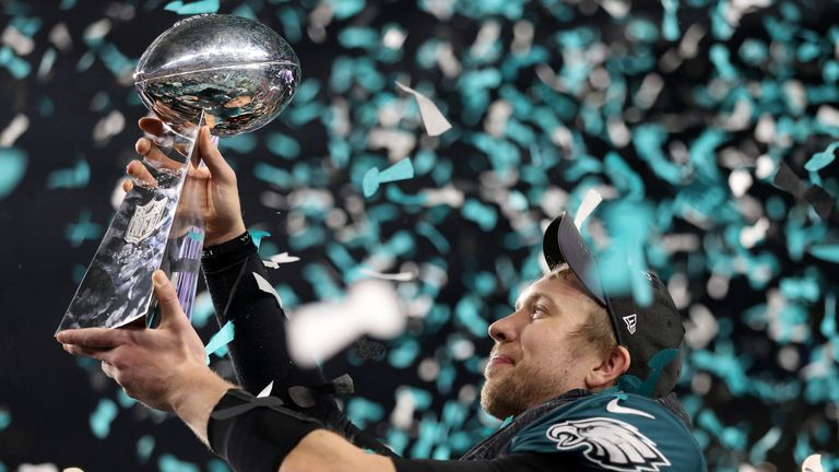 Nick Foles of the Philadelphia Eagles raises the Vince Lombardi Trophy after defeating the New England Patriots 41-33 in Super Bowl LII