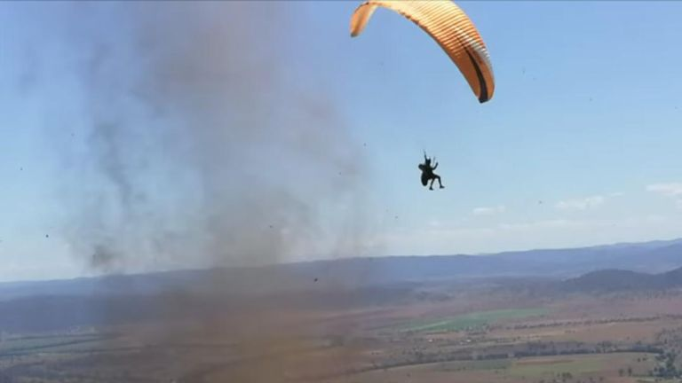 Paraglider is ejected from side of dust devil in New South Wales