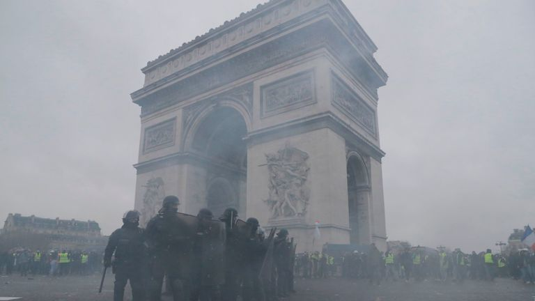 People ran for cover as officers used tear gas in the French capital