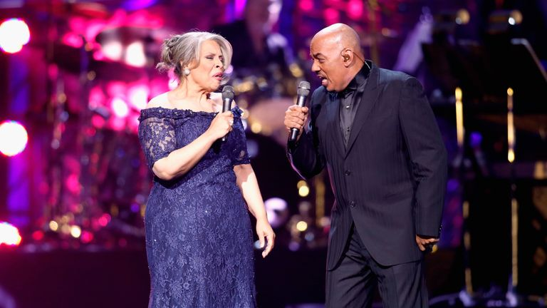 Patti Austin (L) and James Ingram performing onstage in 2013