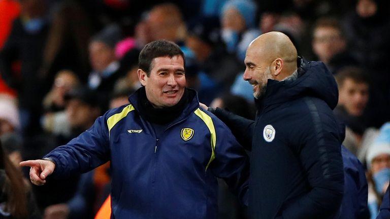 Manchester City manager Pep Guardiola and Burton Albion coach Nigel Clough