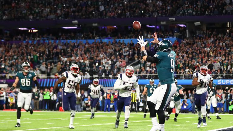 Feb 4, 2018; Minneapolis, MN, USA; Philadelphia Eagles quarterback Nick Foles (9) catches a touchdown pass against the New England Patriots in the second quarter in Super Bowl LII at U.S. Bank Stadium. Mandatory Credit: Mark J. Rebilas-USA TODAY Sports