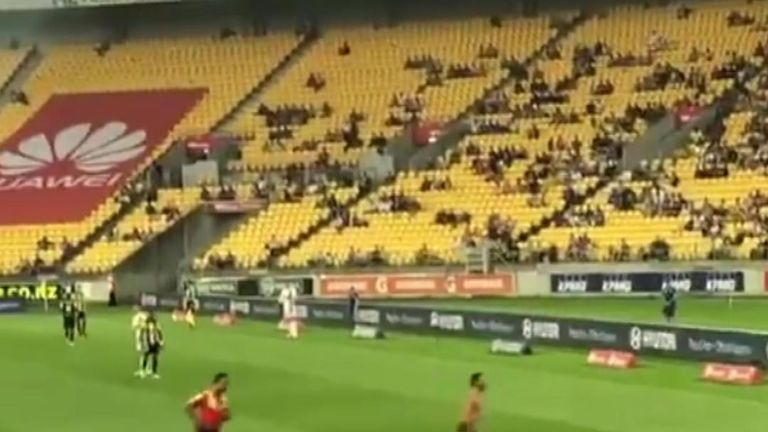 Shirtless pitch invader draws cheers from Wellington football crowd