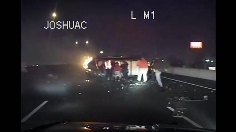 Police and passersby risked their lives to rescue the occupants of a burning SUV in Texas.