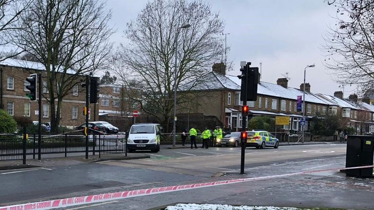 Investigators at work in Forest Road, east London, where a 21-year-old woman has died after being hit by a police car responding to a 999 call
