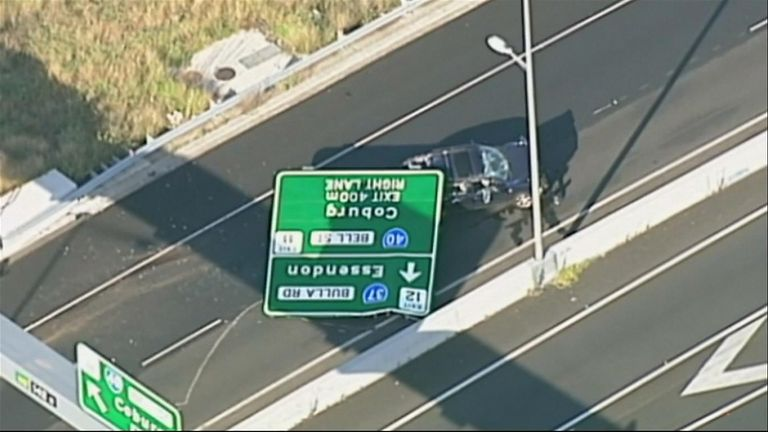 An overhead road sign crashed onto a motorway in Australia, crushing a vehicle and injuring the female driver, who remains in hospital.