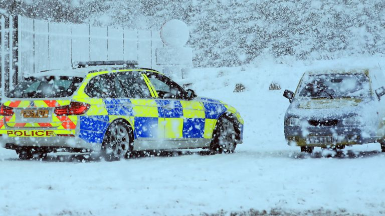 A police car was seen stopped near the Robin Reliant in the snow